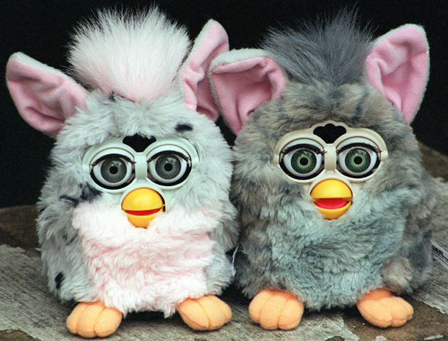The Furby, which featured at the Toy '98 showcase of top toys for Christmas 1998, in London. They arejust over six inches tall and retail at 29.99. 29/11/99: More than 20,000 fake Furby toys were being shredded by game makers Hasbro. * ...as a declaration of war against counterfeiters. The toys have their own language of chirps, cheeps and chirrups and comes complete with an English-Furby dictionary for its 200-words and 800 phrases which include 'a-tay' for 'I'm hungry' and 'way-loh' for sleep.