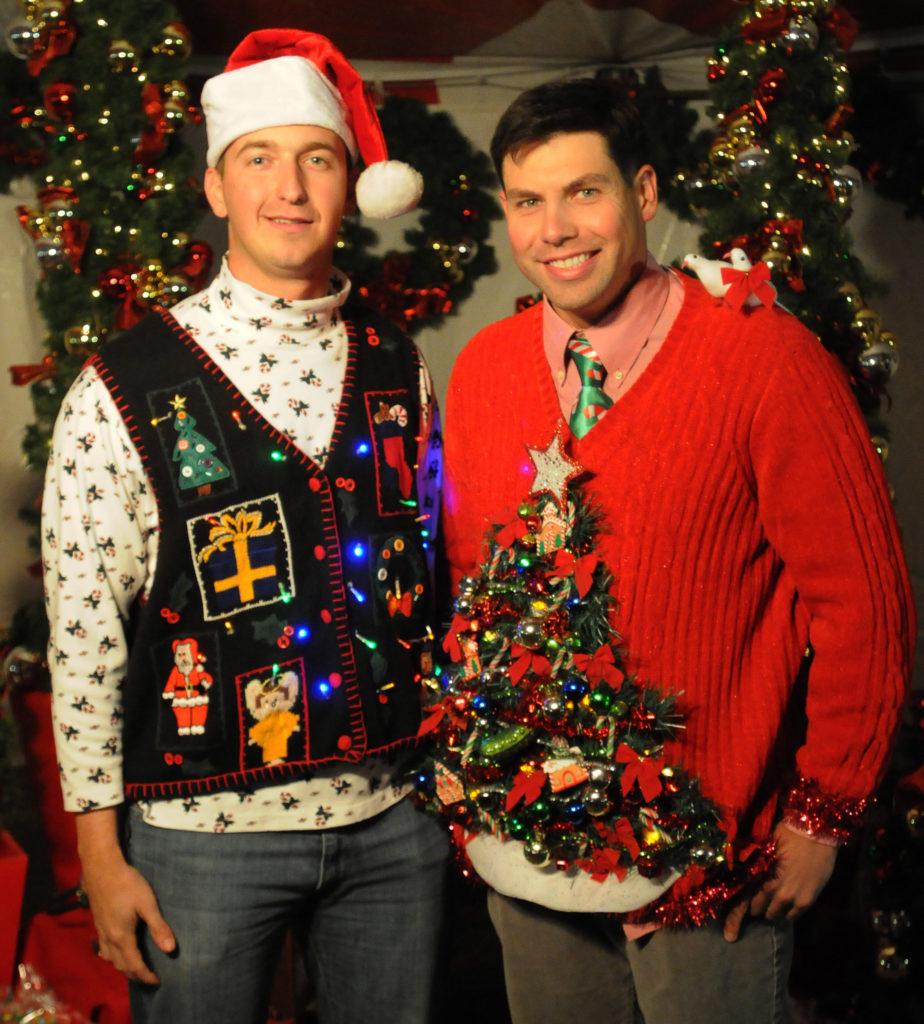 "1st Lt. Jaymes Bell and John Montgomery, both platoon leaders with Company B., 1st ,""Mustangs"" Battalion, 8th Cav. Regt., 2nd BCT, 1st Cav. Div., sport the sweaters they will enter into the ugly sweater contest during the Mustang Winter Fest Christmas Party here, Dec. 11. (Photo by Sgt. Quentin Johnson, 2BCT, 1st Cav Div PAO)"